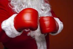 Santa Claus Wearing Boxing Gloves Stock Photos