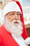 Santa Claus Wearing Glasses Outdoors Stock Photo
