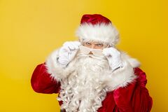 Santa Claus wearing party glasses