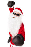 Santa Claus wearing sunglasses with boxing glove Stock Image