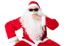 Santa Claus wearing sunglasses and smoking a cigar Royalty Free Stock Images