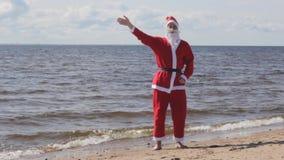Santa claus welcomes sea  vacation new year   holiday. Hello stock footage