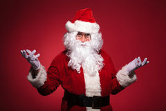 Santa claus is welcoming you Stock Photos