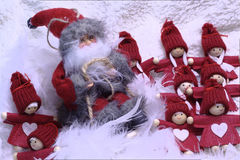 Santa Claus which entertains a group of children Royalty Free Stock Images