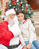 Santa Claus Whispering In Girl's Ear Stock Photos