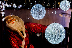 Santa claus with white light balls. Around Royalty Free Stock Images