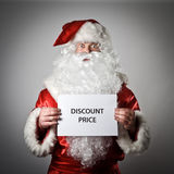 Santa Claus and white paper. Discount price concept. Royalty Free Stock Photo