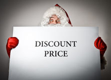 Santa Claus and white paper. Discount price concept. Stock Photography