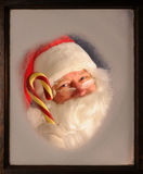 Santa Claus in Window with Candy Cane royalty free stock image