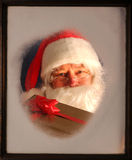 Santa Claus in Window with present Stock Images