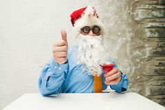 Santa Claus with wineglass Stock Images