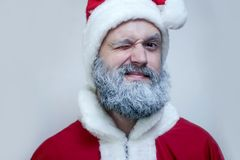 Santa Claus winks stock photography