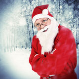 Santa Claus in Winter Forest Stock Photo