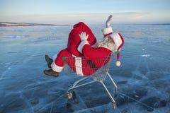 Santa Claus on winter lake ice Royalty Free Stock Photography
