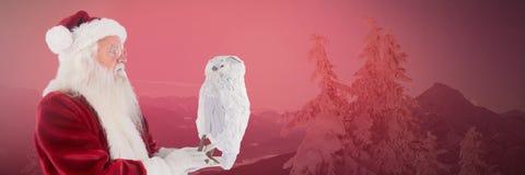 Santa Claus in Winter with owl. Digital composite of Santa Claus in Winter with owl Stock Photo