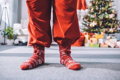Santa claus in winter socks. Cropped shot of santa claus legs in winter wool socks Royalty Free Stock Photos