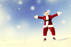 Santa Claus in a Winter Wonderland Jumping Happiness Concept Stock Photography