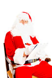 Santa Claus with wish list Royalty Free Stock Photos