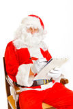 Santa Claus with wish list Royalty Free Stock Images