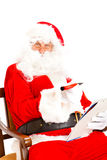 Santa Claus with wish list Stock Photography