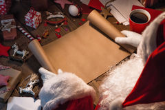 Santa Claus with wish list. Santa Claus with gifts and wish list stock photo