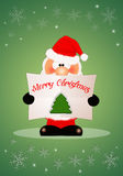 Santa Claus wishes you a Merry Christmas Royalty Free Stock Photography