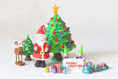 Santa Claus wishes you Merry Christmas in a snowfall Stock Photo