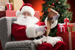 Santa Claus with wishlist in hands Royalty Free Stock Image