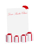 Santa Claus wishlist. White board for Santa Claus wishlist with gift boxes Stock Images