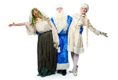 Santa Claus, a witch and a beautiful girl Stock Image