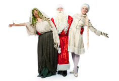 Santa Claus, a witch and a beautiful girl Royalty Free Stock Photography