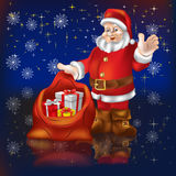 Santa Claus With Gifts On A Black Stock Image