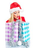 Santa claus woman. Surprised christmas woman with shopping bags - gift. Isolated on white, close up Royalty Free Stock Photo