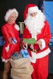 Santa Claus and woman Royalty Free Stock Images