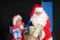 Santa Claus and woman Royalty Free Stock Photos