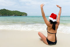 Santa claus woman on beach Royalty Free Stock Photography