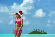 Santa claus woman on beach Royalty Free Stock Photo
