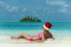 Santa claus woman on beach Stock Photography