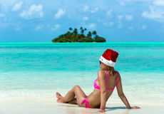 Santa claus woman on beach Royalty Free Stock Photos