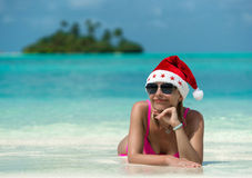 Santa claus woman on beach Royalty Free Stock Images
