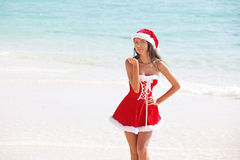 Santa Claus woman on beach Royalty Free Stock Photography