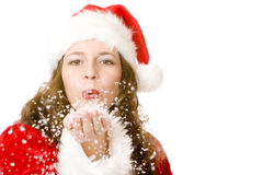 Santa Claus woman is blowing Christmas snow Royalty Free Stock Image
