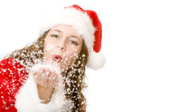 Santa Claus woman is blowing Christmas winter snow Royalty Free Stock Photo