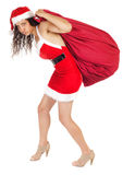 Santa claus woman carrying bag Stock Photo