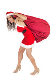 Santa claus woman carrying bag Royalty Free Stock Photos