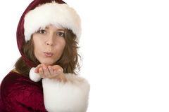 Santa Claus Woman with Christmas cap blowing Royalty Free Stock Images