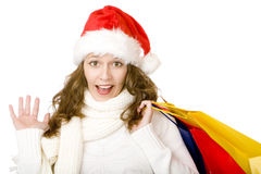 Santa Claus woman with Christmas shopping bags Royalty Free Stock Images