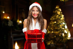 Santa Claus woman giving you a gift Royalty Free Stock Photo