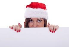 Santa claus woman hidding Royalty Free Stock Image