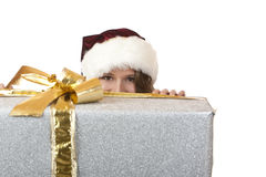 Santa Claus Woman is hiding behind Christmas gift Stock Image